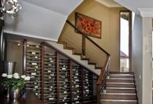 modern-dark-finish-pine-wine-cellar-under-quarter-landing-staircase