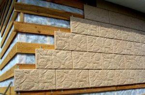 Отделка фасада дома панелями и плиткой